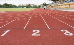 Running track. Number on running track start line stock images