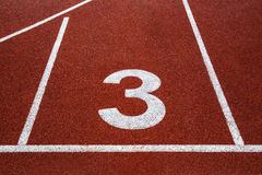 Running track with number 3, texture for background. Stock Photos