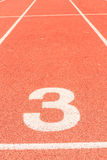 Running track number three. In front of tracks Royalty Free Stock Photos