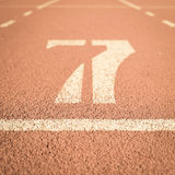Running track number vintage background Stock Images