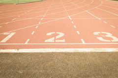 Running track number vintage background Stock Photos