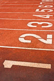 Running Track With Numbered Lanes Royalty Free Stock Images