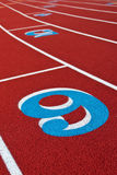 Running Track with Numbers. In Blue and white lines Stock Photos