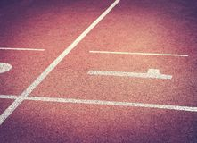 Running Track with numbers 1 Athlete Track. Concept for sports or business competition royalty free stock image