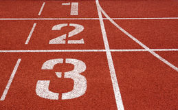 Running track numbers one two three Royalty Free Stock Photo