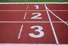 Running track numbers one two three Royalty Free Stock Photos