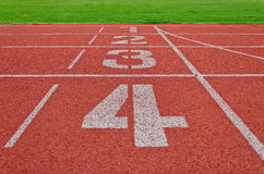 Running track numbers one two three four in stadium Stock Photo