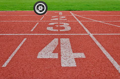 Running track numbers one two three four in stadium with  a wheel Royalty Free Stock Images