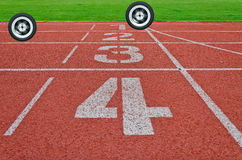 Running track numbers one two three four in stadium Royalty Free Stock Images