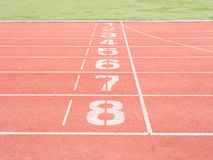 Running track numbers in stadium. One to eight stock images