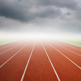 Running track with one lanes with raincloud Royalty Free Stock Photo