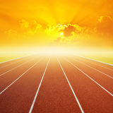 Running track with one lanes with sky sunset. Running track with lanes with sky sunset royalty free stock photos