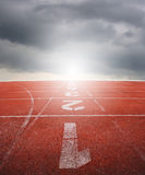 Running track one two three with raincloud Stock Image