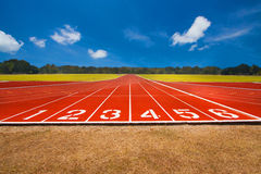 Running track over blue sky and clouds Stock Image