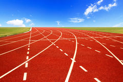 Running track over blue sky Royalty Free Stock Photo