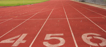 Running track. Red running track with number texture detail Royalty Free Stock Image