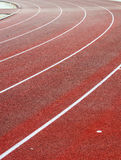 Running track. Red oval running track outside Stock Photos