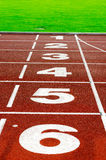 Running track. Red oval running track outside Stock Photography