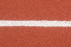 The running track rubber lanes cover texture with line for background Royalty Free Stock Images