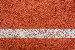 Running track rubber. Standard red color and white line Stock Photos