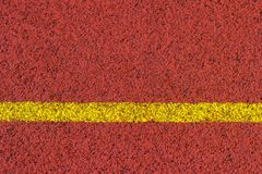 Running track rubber standard red color and yellow line royalty free stock photography