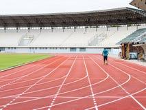 Running track and Runners in stadium Stock Photos