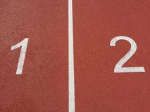 Running track. Number one and Two Royalty Free Stock Photo