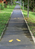Running Track. Singapore - July 2016 Running track in an housing estate with yellow shoe prints stock photos