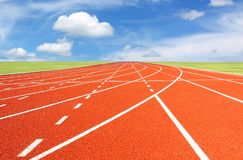 Running track with sky and clouds Stock Images