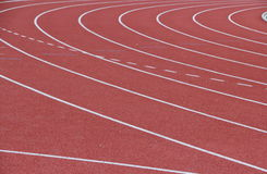 Running track in stadium. Runway with crossed white lines. athletic plastic run track in stadium Stock Image