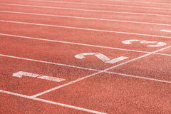 Running track on a stadium with lane numbers Royalty Free Stock Images