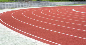 Running track in stadium. Racetrack, red rubber racetracks in big stadium evening Stock Photography