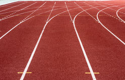 Running track in stadium. Racetrack, red rubber racetracks in big stadium evening Royalty Free Stock Photography