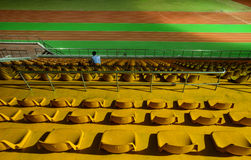 Running track and stadium seats at night Stock Photography