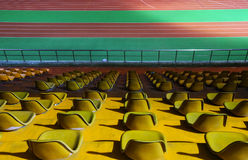 Running track and stadium seats at night Royalty Free Stock Images