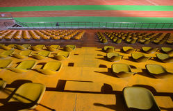 Running track and stadium seats at night royalty free stock photography