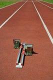 Running track with starting blocks Royalty Free Stock Photo