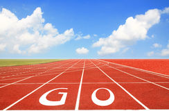 Running track with three lanes over sky Stock Photography