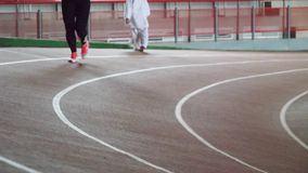 Running track in the track and field indoor arena. Running track in the track and field indoor arena stock footage