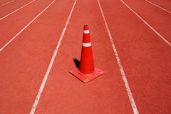 Running track with traffic cone Stock Images