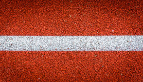 Running track with white line rubber texture. Top view rubber Stock Image