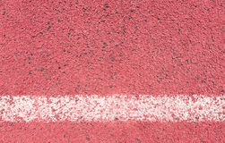 Running track with white line texture and background. Stock Image
