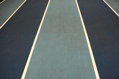 Running track with white lines Royalty Free Stock Photography