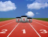 Running track and winner's podium Stock Images