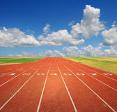 Running Track With Clouds Royalty Free Stock Images