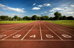 Running tracked with numbered lanes Stock Photo