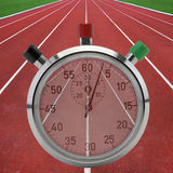 Running tracks with stop watch Royalty Free Stock Photos