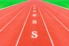 Running tracks with success word Stock Photos