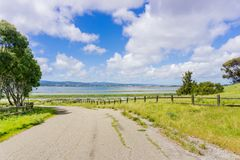 Running trail in Bedwell Bayfront Park on the shoreline of San Francisco bay. Menlo Park, California; white clouds and blue sky in the background Stock Photo