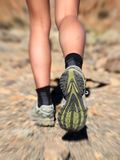 Running trail shoes - feet / legs closeup Royalty Free Stock Photography